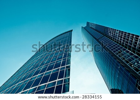 Two modern buildings blue tones - stock photo