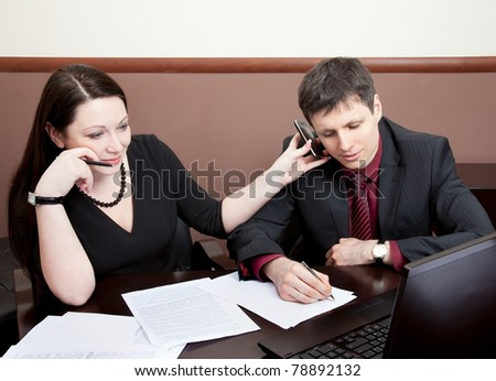 Two modern businesspeople at the meeting in the office - stock photo
