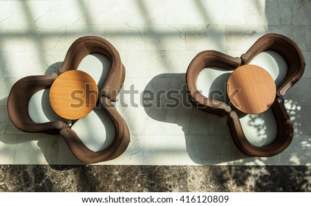 Two modern cafe tables and armchairts. High angle shot - stock photo