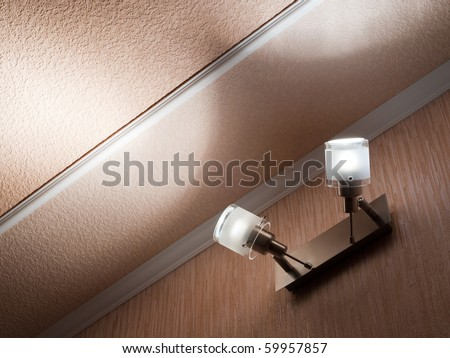 Two modern ceiling lights mounted on a wall - stock photo