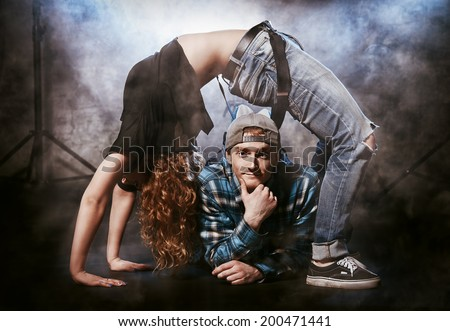 Two modern dancers over grunge background. Hip-hop. Urban, disco style. - stock photo