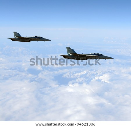 Two modern military jet fighters above mountain tops - stock photo