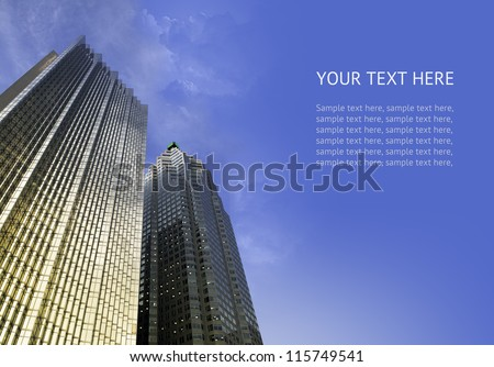 Two modern skyscraper buildings on a background of blue sky with some clouds. Design composition with sample text. - stock photo