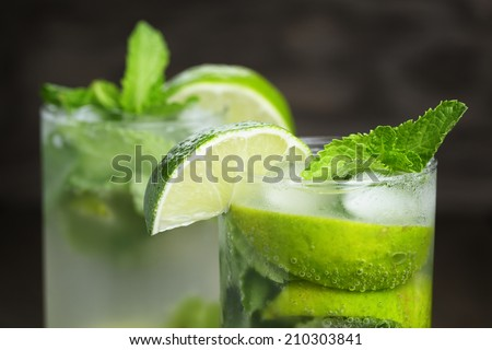 two mojito cocktails on old oak table, rustic style - stock photo