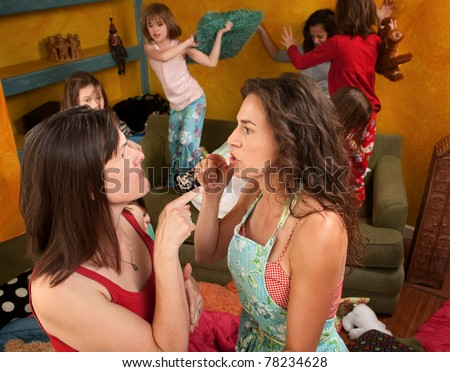 Two mothers argue and point at each other among wild kids - stock photo