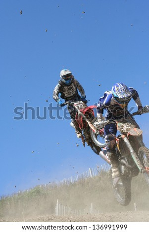 Two motocross bikes in mid air - stock photo