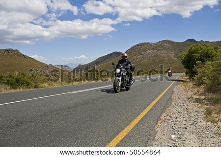Two motorcyclists exploring the South African countryside - stock photo