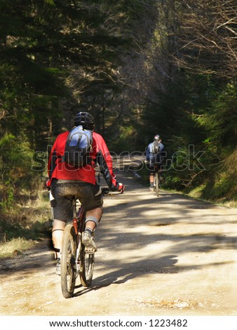 Two Mountain Bikers in the woods - stock photo