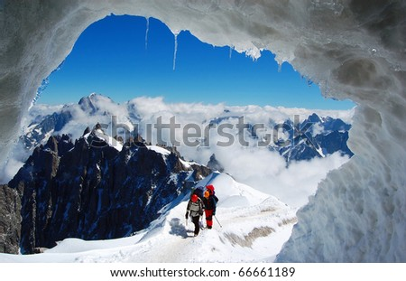 Two mountaineers on a French glacier (Mont Blanc Massif, French Alps) - stock photo