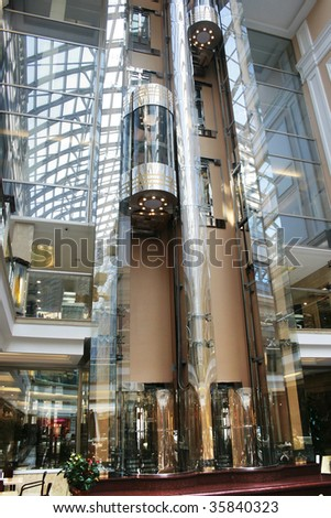 Two moving elevators in shopping centre - stock photo