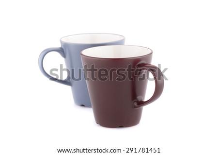 Two mugs isolated on white background. - stock photo