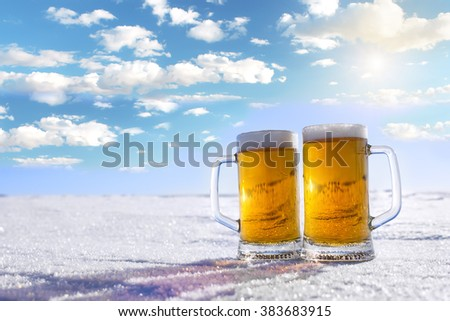 Two mugs of cold beer on the nature