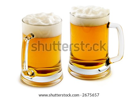 Two mugs of delightful amber beer with the big foam - stock photo
