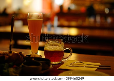 Two mugs of traditional Czech beer - Stock Image - stock photo