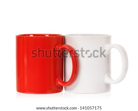 Two mugs �¢?? white and red, isolated on white background - stock photo
