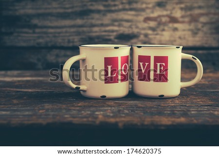 Two mugs with love letters - stock photo
