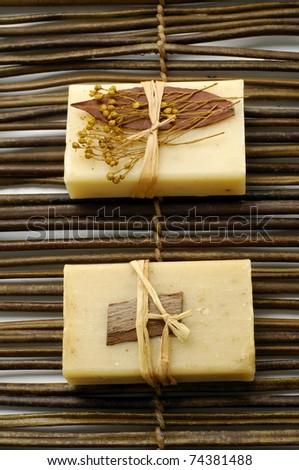 Two natural handmade Soap the bamboo mat - stock photo