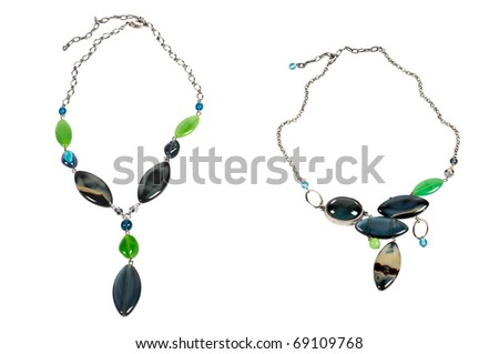 two necklaces with green and blue beads over white - stock photo