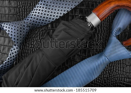 Two neckties  and  wallet   lying on the skin, can be used as background - stock photo