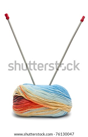 Two needles in colorful yarn isolated on white - stock photo