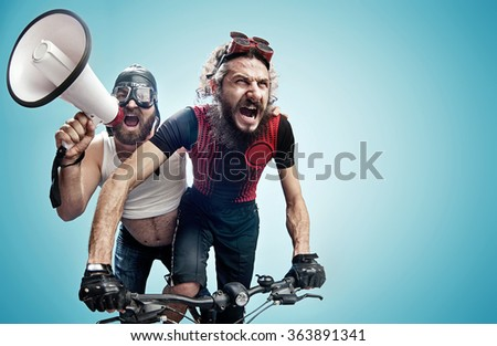 Two nerdy guys with a megaphone - stock photo