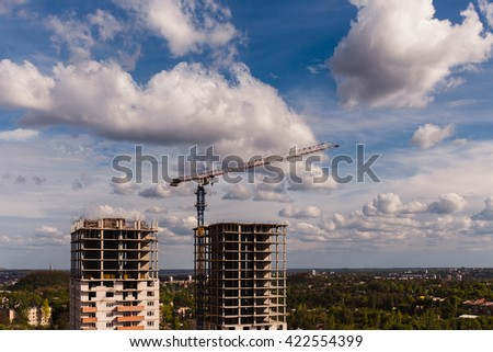 Two new building high-rise buildings against a beautiful sky with clouds - stock photo