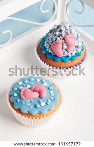 two newborn baby boy cupcakes on a plate - stock photo