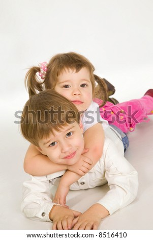 Two nice children embracing over white