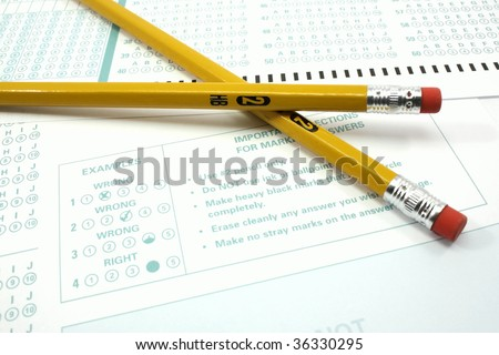Two number 2 pencils and a bubble test sheet with instructions.