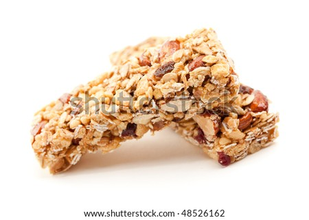 Two Nutritious Granola Bars Isolated on White with narrow Depth of Field. - stock photo