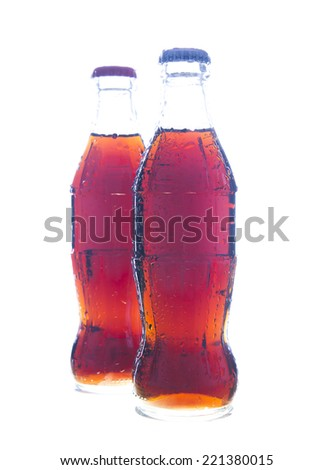 Two Object of full bottle with transparent drops of coca soda cola  isolated on a white background Wet jar without label fresh brown or black drink  - stock photo