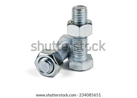 Two of metal screws and nuts isolated on white background - stock photo
