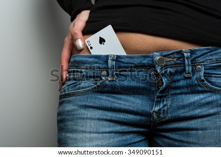 Two of spades playing card combinating with blue jeans - stock photo