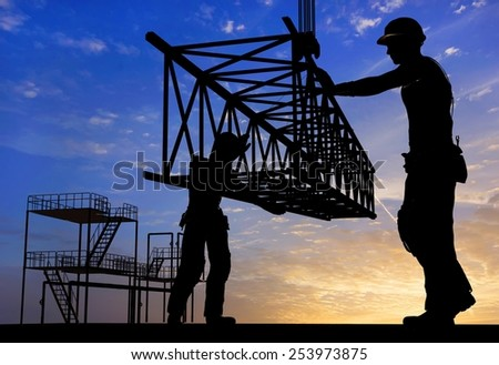 Two of the builder and the hook. - stock photo