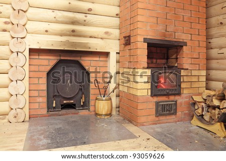 Two of the stove in a wooden log bath, for heating and steam rooms - stock photo
