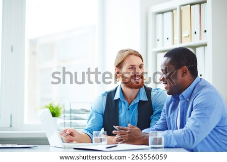 Two office workers talking about business - stock photo
