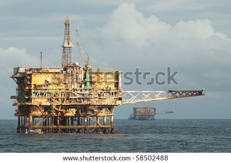Two offshore oil rigs.  Coast of Brazil - stock photo