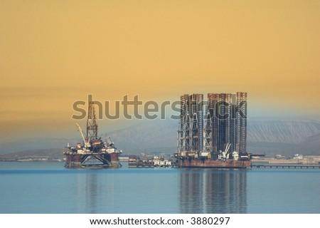 Two offshore rigs at  Caspian shore near Baku - stock photo
