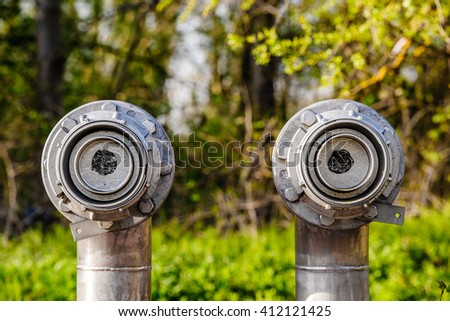 Two oil and gas pipes closed in the middle of the forest for environmental protection reason - stock photo
