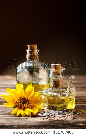 Two oil bottle with sunflower and seeds - stock photo