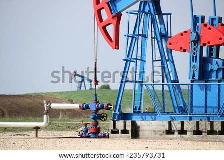 two oil pump jack and pipeline - stock photo