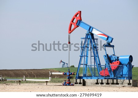 two oil pump jack on oilfield - stock photo