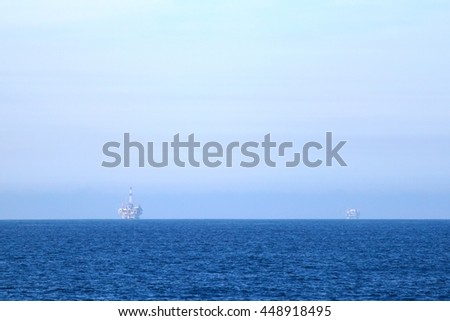 Two oil rigs in front of the Ventura coast. - stock photo