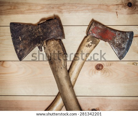 Two old ax on a wooden background. top view - stock photo