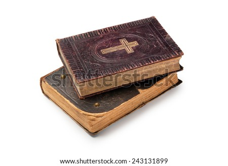 Two old bibles on white background - stock photo
