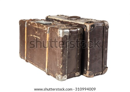 Two Old Brown used and weathered suitcase isolated on white background