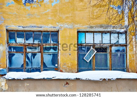 Two old damaged and iced windows - stock photo