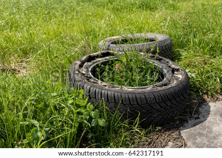 stock-photo-two-old-damaged-tires-lie-on