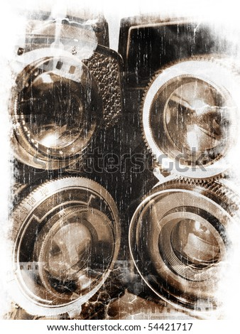 Two old dual-lens cameras (vintage style, with a grungy effect added) - stock photo