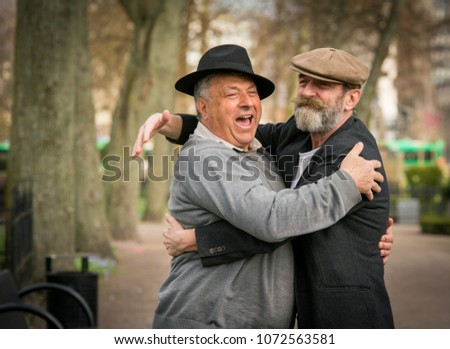 stock-photo-two-old-friends-in-hats-meet